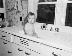 Kitchen Sink Baby: c. 1953- this is where all babies had their baths...