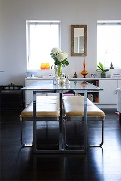 vintage chrome and glass dining room table keeps room feeling light and spacious