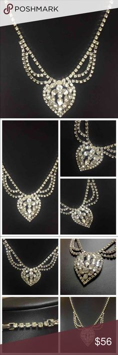 """PROM??? STUNNING VERY VINTAGE RHINESTONE NECKLACE PROM??? Absolutely stunning Very Vintage Rhinestone Necklace. The dazzle when light hits each faceted stone, is out-of-this-world show-stopping! With (2inch) extender, that can be removed, it's approximately 18 inches WITHOUT attached pendant. The """"semi-heart"""" shaped portion, is approximately 2 1/4 inches top to bottom, and 1 3/4 inches, left to right. NOT including the gorgeous double strand draped pieces on either side. Full length of…"""