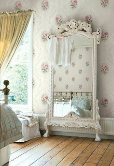 White shabby chic mirror. Elegant bedroom decor with pretty accents.