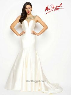 White pageant gowns are a classic go-to. This Dutch satin, illusion, sweetheart neckline, floor length, trumpet pageant gown is perfect for your next competition. Rock the eveningwear competition in this gown with crystal detailing and low scoop back and exaggerated sweep train.  62580Y | Mac Duggal