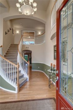 Beautiful entryway with high ceilings, leading up to unique curved staircase. 8522 NE 128th St, Kirkland , 98034