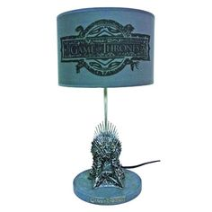 Light up your castle with this neat Game of Thrones Iron Throne Table Lamp. You won't have to join the fight for the Iron Throne since you will have it attached Iron Throne Replica, Game O Thrones, 60 Watt Light Bulb, Dark Words, Game Of Thrones Merchandise, Throne Room, Geek Games, Games To Buy, Valar Morghulis