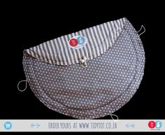 Dots and Stripes have proved so popular that we we're delighted to include this lovely Dove Grey TIDY TOT to our range. For the discerning Mum you cant go wrong if you chose this beautifully PADDED, made for comfort and convenience, TIDY TOT.