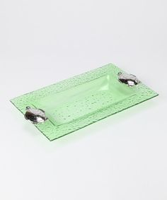 Display tasty treats for a backyard barbecue or poolside party with this pleasing tray. It's made of glass with sturdy ocean critters to keep watch over the appetizers.14'' W x 8.5'' HGlass / metalHand washImported