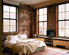 Bedroom with brickwall. Very simple and clean.