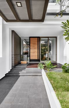 Main entrance and car porch. — at Jalan Langgar Bedok. Modern Porch, Modern Entrance, Entrance Design, House Entrance, Door Design, Exterior Design, Main Entrance, House With Porch, House Front