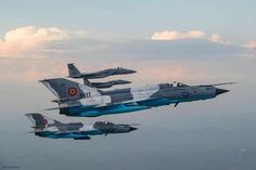 Romanian MiG-21 in formation with USAF F-15C By Frank Crebas