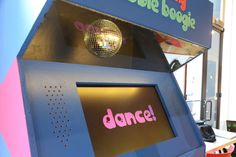Big Bang Bubble Boogie is a collaborative game for any number of players that marries the game mechanics of Dance Dance Revolution (DDR) and whack-a-mole.  The purpose of the game is to hit the button the corresponds to the color of the bubble that appears on the screen. As the player goes through levels, more bubbles appear at a faster rate.