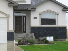 Home exterior black rundle country ledgestone cultured for How to install stone veneer over stucco