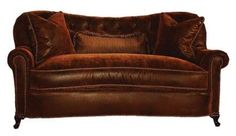 Telluride sofa.  A silken-sumptuous cushion top befriends buttery-soft leather in a plump couch for two. From a time-honoured furniture maker in North Carolina.