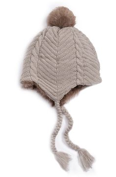 Classic cable knitting creates a cozy look and feel on this plush beanie accented with a fluffy faux-fur pom.
