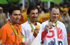 Fabian Cancellara (centre) won gold withTom Dumoulin of Holland  finishing…