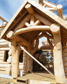 Entry construction of a waterfront log home in Ontario  For more photos or this…