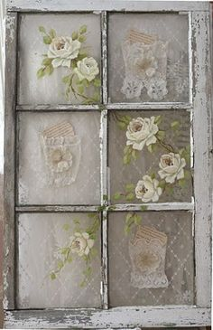 Old window with vintage lace behind the panes and roses painted on the glass & little lace pockets.