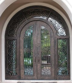 Iron Entry Door with mirror glass can give a beautiful look to the exterior of your home