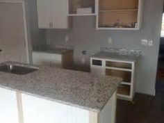 The Dallas White Granite looks great with the white cabinets and the ...