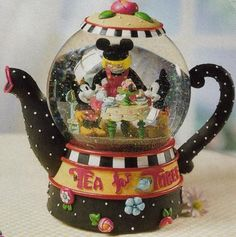 Artwork designed by Mary Engelbreit portraying a tea party with a ragdoll Mickey and Minnie.