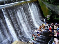Restaurant Labasin Waterfalls, Villa Escudero, San Pablo, Quezon, Philippines; dining as water is running over your feet would certainly create a memorable experience.  Also offered is a vast hacienda filled with comfortable rooms, and a museum of curious things