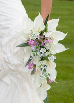 Brides bouquet with lilies and freesia... by Emma Hall Designs