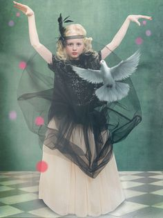Partywear for girls is in monochrome colour with plenty of tulle and sparkle at NORO for holiday 2015