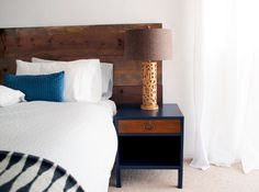 love the navy and wood dresser!    apartmenttherapy.com  -amazing!