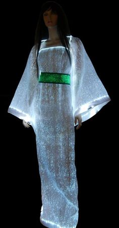 fiber optic dress... apart from the cool technology, i really love the way this dress looks... its kind of surreal, and elegant, flows beautifully