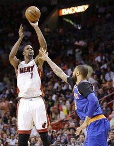 Miami Heat center Chris Bosh (1) shoots against New York Knicks center Tyson Chandler. Keep your hand in his face Ty!