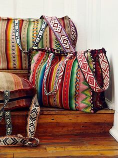 Castilla Tote   Oversized artisan tote, made of Peruvian hand-stitched woven textiles. Embroidered strap and handles, with a zip closure. *By Bluma Project **Special Note: Color and pattern varies; each bag is handmade and slightly unique!