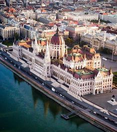 """""""A Buda-ful view over Budapest."""" Want to see intricate architecture like this up close? Head to the link in our bio for a complete guide to Hungary's capital. Drone photo and sweet pun by Beautiful Places To Travel, Most Beautiful Cities, Wonderful Places, Wachau Valley, Budapest Travel Guide, Places Around The World, Around The Worlds, Belle Villa, Prison"""