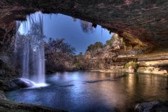 Hamilton Pool Nature Preserve (Dripping Springs, 37 miles on Highway 71 west of Austin, Texas) is one of the most beautiful places in the world. A subterranean lake coming to the surface from under the stone arch grotto is complemented with a waterfall.