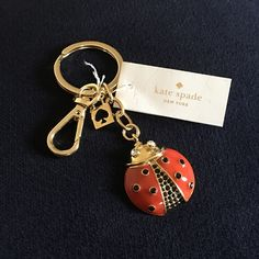 KATE SPADE LADYBUG KEYCHAIN AUTHENTIC KATE SPADE. New never used. Gold with red enamel and black/clear crystals. NO TRADING!! Reasonable offers welcomed no low balling pretty please. Thanks for stopping by my closet  kate spade Accessories Key & Card Holders