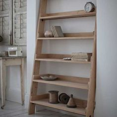 Simply rest the graded shelf against the wall for a striking and unusual home for books, ornaments and plants.