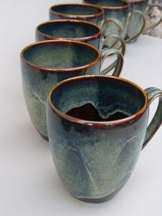 Porcelain cup with black and blue-green iridescent glaze