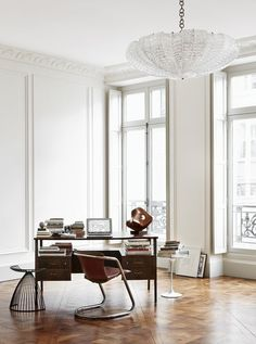 Chic and elegant Parisian style office with stunning chandelier and desk