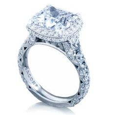 Channels of graduating diamonds curve into the ceiling of this distinctive engagement ring, featuring two rows of blooming diamonds to enhance the princess-cut center diamond. Tacori RoyalT Style # HT2624PR9 #arthursjewelers