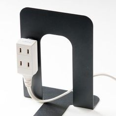 Use a magnet to attach an extension cord to a metal bookend. This would come in handy for any light-up displays on the shelves. Just conceal behind books, etc. Fashion Background, Home Management, Office Storage, Diy Interior, Life Organization, Working Area, Smart Home, Clean House, Storage Spaces
