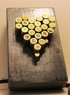 What to do with all those bullet casings the kids find during campout. Bullet Casing Heart by Reinspiredme Shotgun Shell Crafts, Shotgun Shells, Bullet Art, Bullet Shell, Ammo Art, Wood Crafts, Diy Crafts, Ammo Crafts, Bullet Crafts