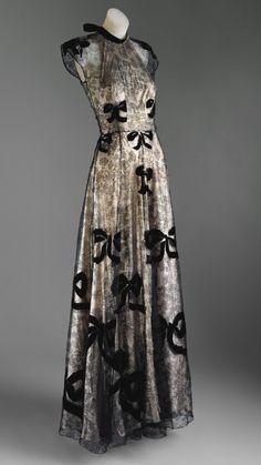 Vionnet ... black lace, velvet appliqués over a silver lamé halter bias under dress