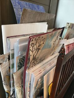 Favourites making it into the antique letter rack atop the fabric table