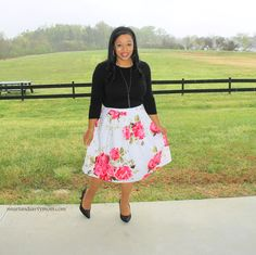 black top with pink and white pleated floral print spring time skirt. modest outfit idea