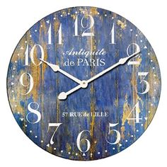 Weathered wood wall clock with a plank-style face and typographic motif.  Product: Wall clockConstruction Material: ...