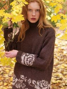 This oversized, slouchy jumper is made more feminine with pretty flower motifs. Designed by Martin Storey using Felted Tweed Aran.