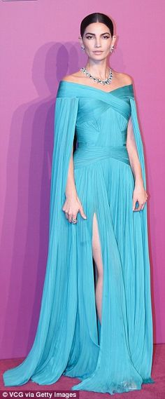 Fancy: The 32-year-old model wowed in her exquisite aqua J. Mendel gown with caped sleeves and a ruched texture, adding Bulgari jewelry