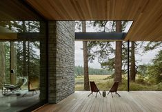 Glass house surrounded by a tranquil forest setting on Whidbey Island #outdoors #outdoorliving #deck #house Tamizo Architects, Chicken Shed, Agricultural Buildings, Basalt Stone, Whidbey Island, Glass House, Maine House, Modern Family, Cladding