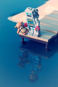 lego mini figure and bear