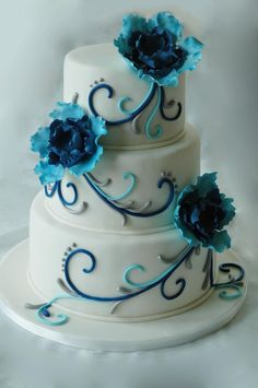 royal blue and turquoise flowers and scrolls wedding cake.  www.1gateau.com