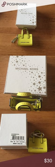 Original Michael Kors mini key charm Brand new I am selling an original Michael Kors key charm.   This little gem is in a canary yellow color and is made exactly like the big Hamilton style purse.   No marks or wear, it comes with the original packing and box.   Great stocking stuffer for the Michael Kors fan in the house.   Please no trades Michael Kors Accessories Key & Card Holders
