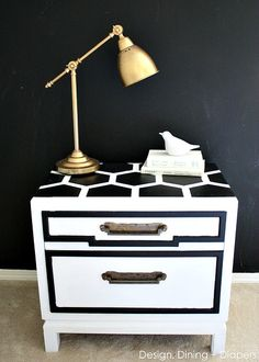 This bold black and white side table was created with white paint and chalkboard paint.  The matt finish from the chalkboard paint gives out the perfect contrast against the white paint and brings out the stunning honeycomb pattern.