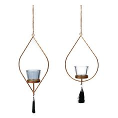 This Set of 2 Gold Hanging Tealight Holder with Green Tassels are a quirky, bohemian style decor choice for lovers of gold decor and glamorous design. Available in two different designs, these tealight holders have a metallic gold finish with a glass tealight holder in the middle and a Green tassel at the bottom. A stylish hanging decoration for any room, these gorgeous candle holders would add a touch of glamour to a variety of interiors and would make lovely party decor.
